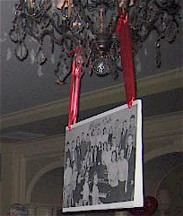 Enlarged Yearbook photo hanging from chandelier.