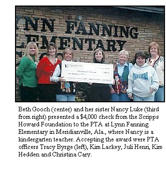 Beth Gooch and her sister Nancy present check to PTA