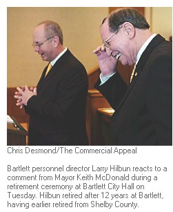 Bartlett personnel director Larry Hilbun reacts to a comment from Mayor Keith McDonald during a retirement ceremony.